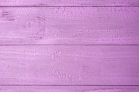 Close-up of old natural wooden planks painted in beautiful pale pink color with cracks. Textured background with horizontal layout and copy space. View from above. Stok Fotoğraf