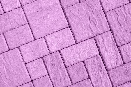Highly detailed street pavement background with diagonal geometric pattern made of various square blocks with textured rough surface toned in pastel pink color. View from directly above. Copy space. Stok Fotoğraf