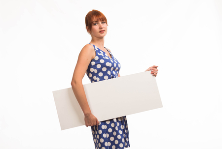 Young enigmatic woman portrait of a confident businesswoman showing presentation, pointing placard background. Ideal for banners, registration forms, presentation, landings, presenting concept.