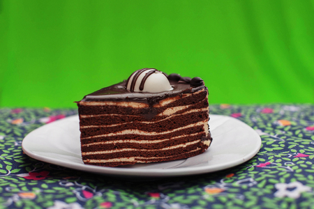 chocolate cake on a green tablecloth Stock fotó