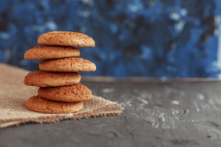 Oatmeal cookies on sacking. Background. The concept of healthy eating and vegetarianism.