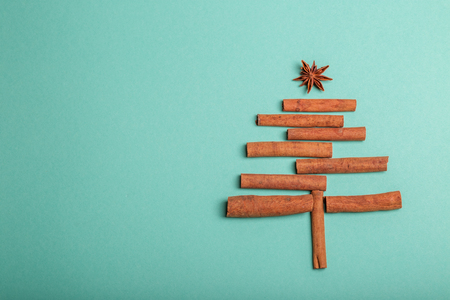 New Year background with cinnamon and anise. Concept Happy Christmas, new year, winter, greetings, celebration. Stock Photo