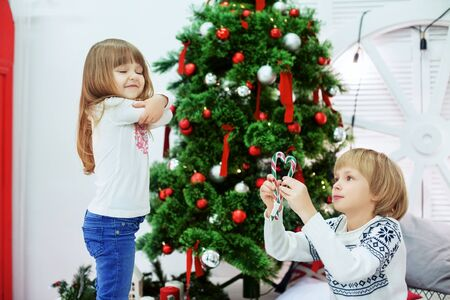 ittle sister offended brother. The concept of Christmas and New Year.