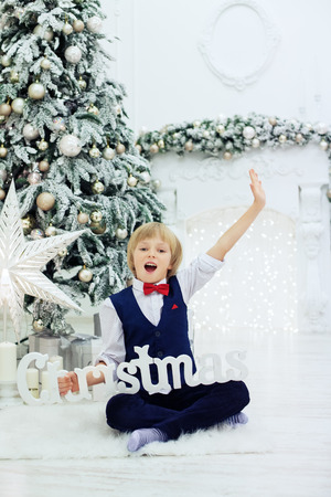 little boy greets holidays. The concept of Christmas Stock Photo