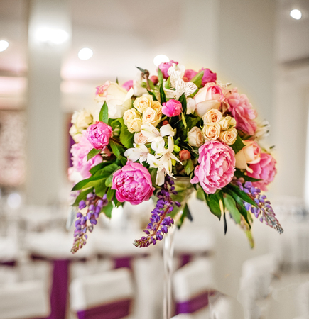 Beautiful flowers. Decor on the table. The concept of a party and wedding decor.