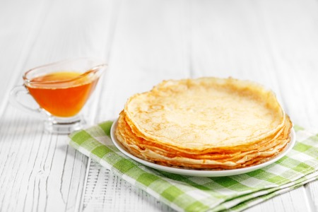 Delicious sweet pancakes with honey on the table. The concept of food, breakfast,  pancake week.