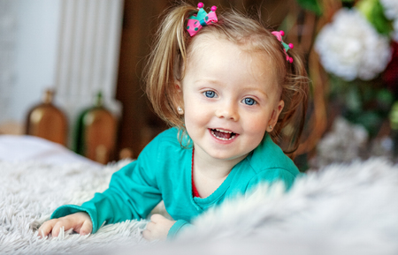 Cheerful little baby playing in the room. 2-3 years. The concept of childhood and lifestyle.