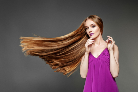 Beautiful woman with a very long, healthy hair. The concept model and beauty.