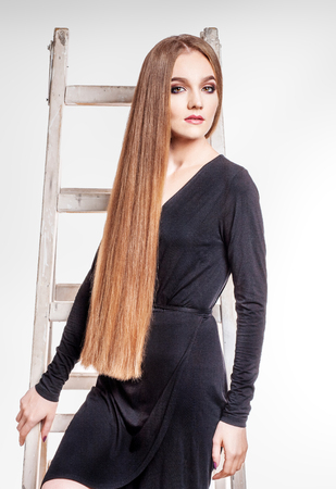 Beautiful girl has a very long healthy hair. The concept model and beauty.