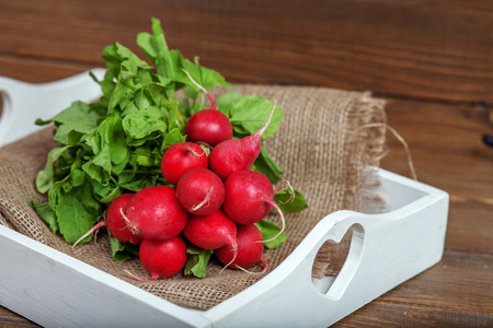 Helpful tasty radish. The concept of healthy eating and vegetarianism.