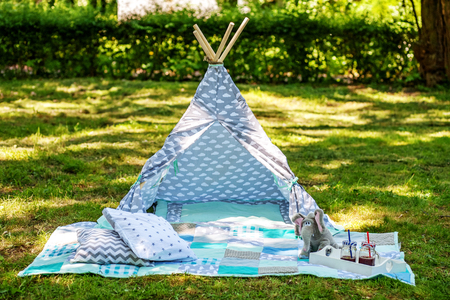 Wigwam for small children. The concept of lifestyle and decor.