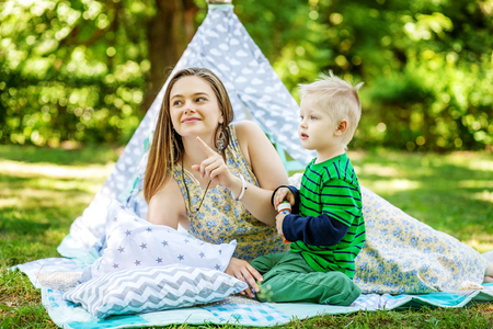 Happy mother and little son in the park. The concept of lifestyle and childhood. Stock Photo