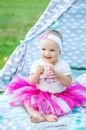 Little infant playing toy in the park. Concept of children, childhood, lifestyle, family.