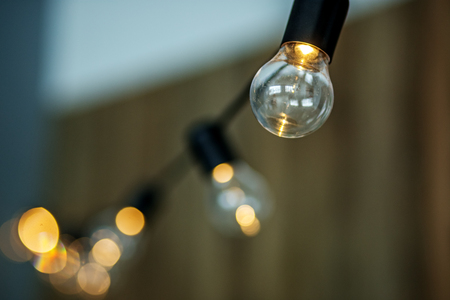 Suspended bulbs on a brown background. The concept is part of the interior, the decor.