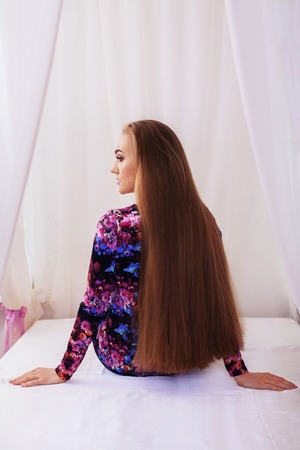 Straight is very long hair. The concept of lifestyle, fashion, health.