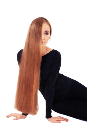 Young girl with very long straight hair. The concept of lifestyle, fashion, health. Фото со стока