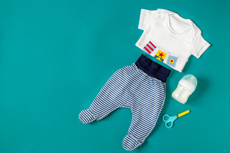 Baby Clothing. Pants and T-shirt. Concept of newborns, motherhood, care, lifestyle.
