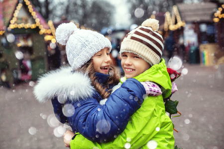 Children boy and girl met in the city, hugging and rejoicing. The concept of lifestyle, love, Valentines Day.