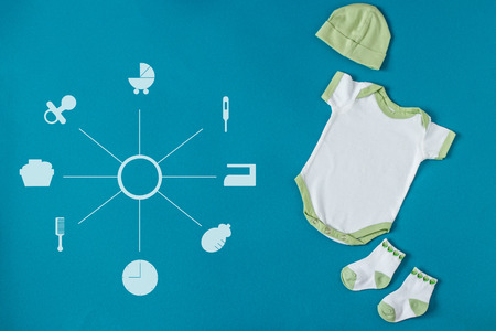 Baby Clothing. Hat and socks. Concept of newborns, motherhood, care, lifestyle.