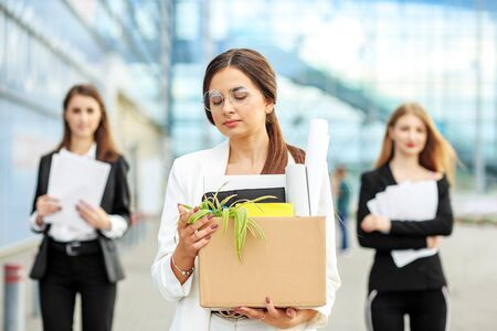 A young beautiful woman was fired from her job. The end of a career. Concept for business, unemployment, labor exchange and dismissal
