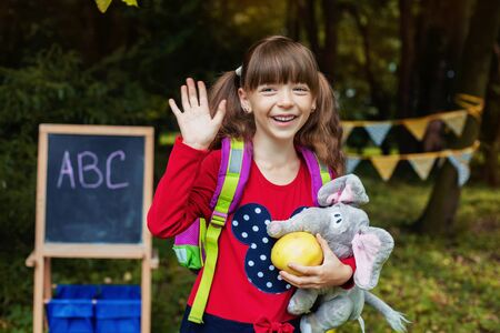 Cheerful schoolgirl with a backpack. Back to school. The concept of education, school, childhood