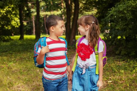 Children with backpacks. Back to school. The concept of education, school, childhood Фото со стока