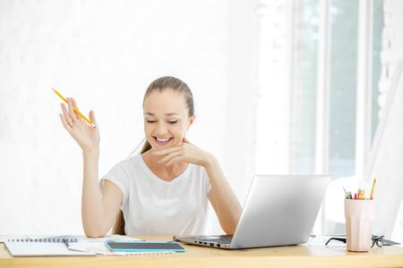 Successful happy woman works in the office. Concept for business, work, career and success. 写真素材