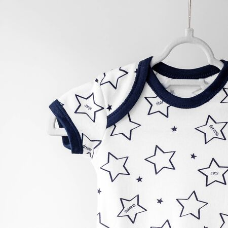 Clothing for a newborn in stars. The concept of clothes, motherhood, fashion and newborn.