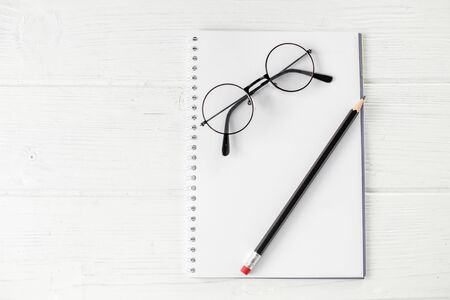 Blank notebook, pencil and glasses. The concept of school, creativity, childhood and work.