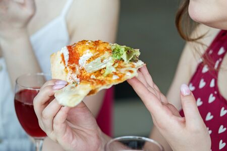 A delicious slice of pizza. Concept of food, fast food, pizzeria. Stock Photo
