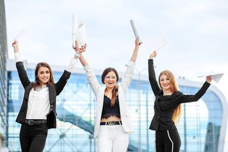 Business women won the competition. The girls passed the exam. Concept for business, employees, partners and entrepreneurs.