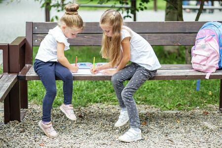 Children schoolchildren draw and play. The concept of school, study, education, friendship, childhood.