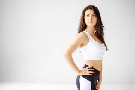 Young adult girl in sportswear. Place for text. The concept of sports, healthy lifestyle, fitness, stretching 写真素材