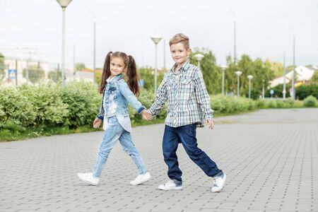 Little friends go hand in hand. The concept of childhood, back to school, friendship and family.