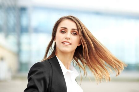 Beautiful woman dressed in a business style. Runs to work. Concept for lifestyle, business, movement, motivation.