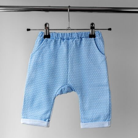 Blue panties for the baby. The concept of clothes, motherhood, fashion and newborn.