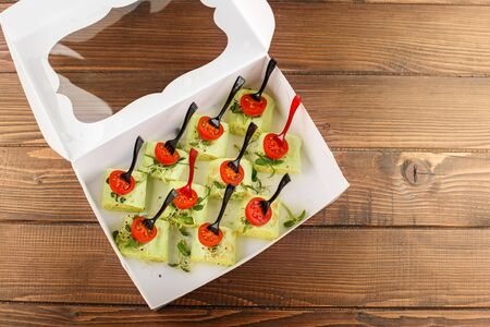 Tasty rolls with pita bread, cheese and micro greens. Food delivery in packaging. The concept of food, catering, banquet. View from above.