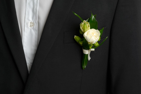 buttonhole: Nice and beautiful buttonhole in the bridegroom pocket