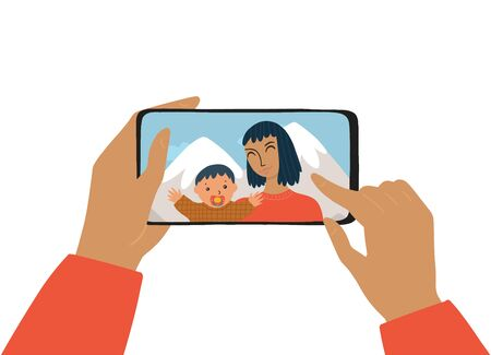 The female hand holds a smartphone. The concept of photography, chat, video call. Woman and kid smiles and takes a selfie. The mother and her son take a photo in the vacations.