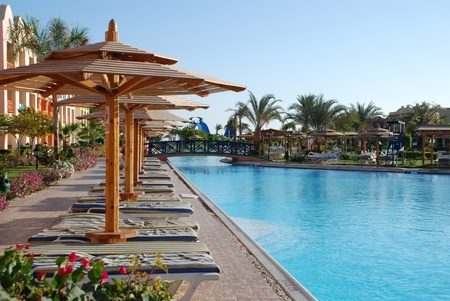 Pool with the bridge in territory of hotel Titanic the Oriental carpet. Egypt. Hurgada.