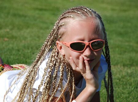 The girl in pink glasses with the African plaits Stock Photo - 11746531
