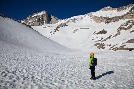 alpinist: Alpinist looking at the summit to climb Stock Photo