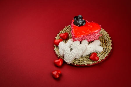 Sweet valentine s hearts on the wicker stand and red background photo