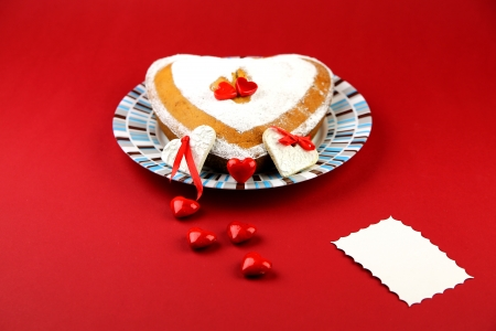 Valentines cake and little hearts on the pink background with the place for the sample text photo