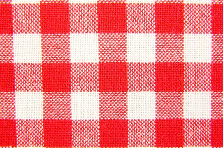 Textile texture in red and white cell. photo