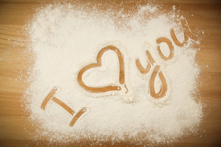 Flour on the table with text I LOVE YOU photo