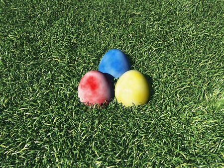 3d render of 3 easter eggs lying on grass Stock Photo