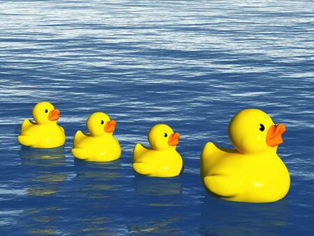 Rubber Duck Family on the Ocean Stock Photo