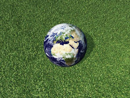 3d render of Earth lying on grass