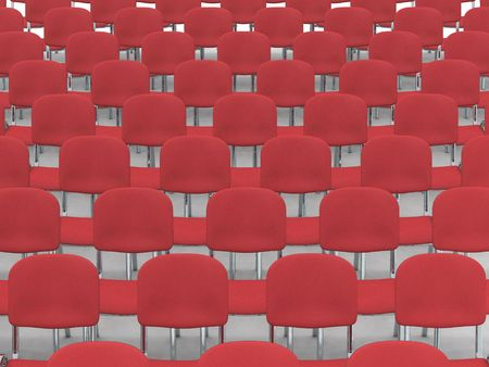 digital render of an empty auditorium of red chairs